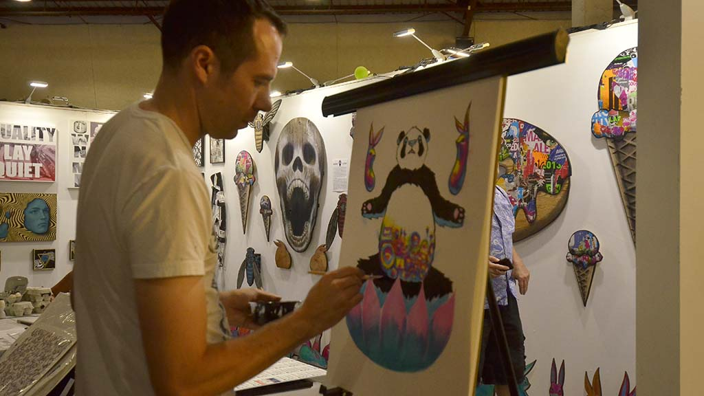 Max Neutra works on his art at KAABOO Del Mar.