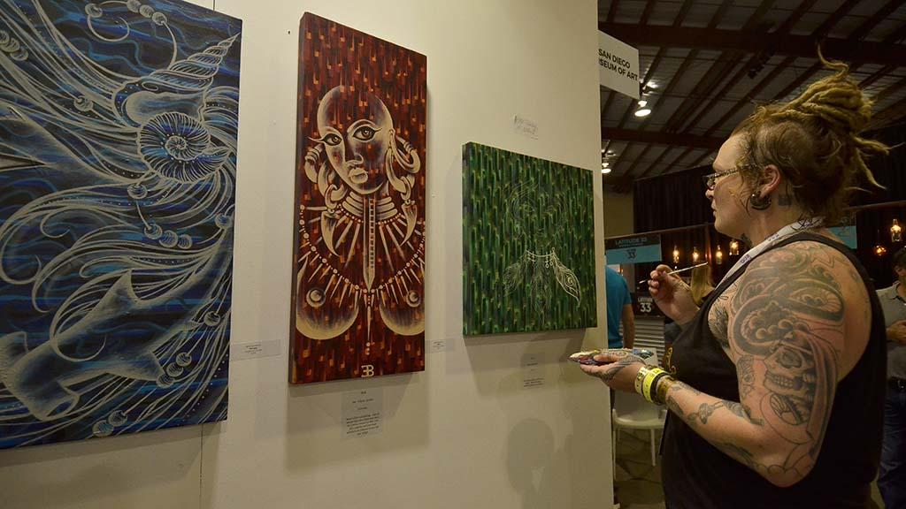 Artist Beth Emmerich works on her art at KAABOO Del Mar.