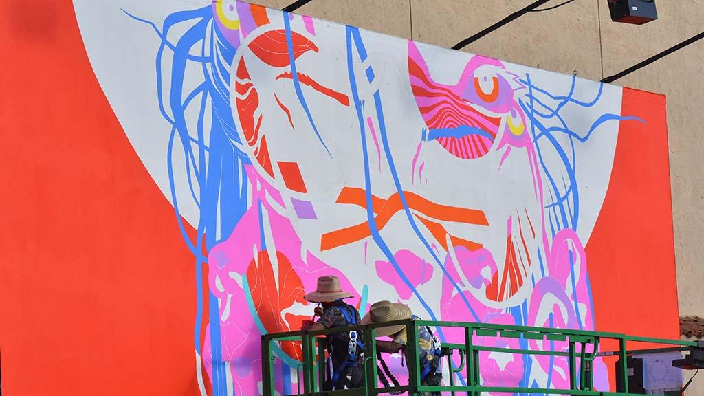 Artists finish a mural at KAABOO Del Mar.
