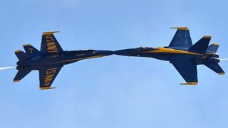 An optical illusion makes it look like speeding Blue Angels are meeting mid-air.