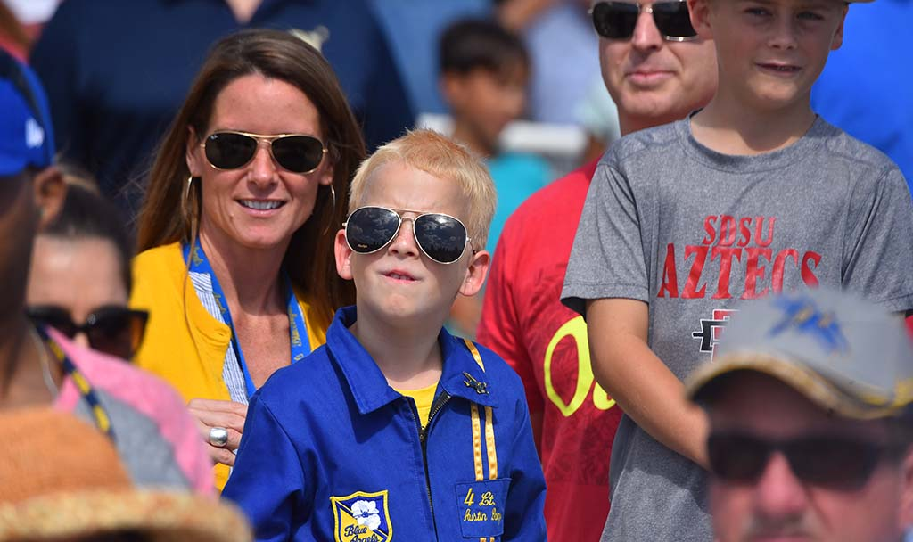 A son of a Blue Angel pilot watches the flight team perform at the Miramar Air Show.