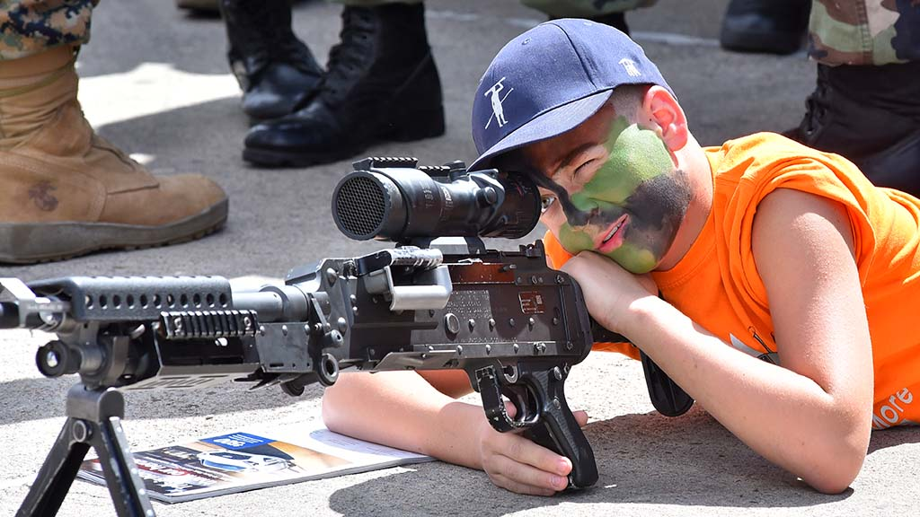 A boy scopes out a weapon at the 2017 Miramar Air Show.