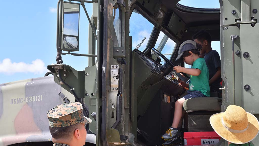 Children get behind the wheel of military vehicles