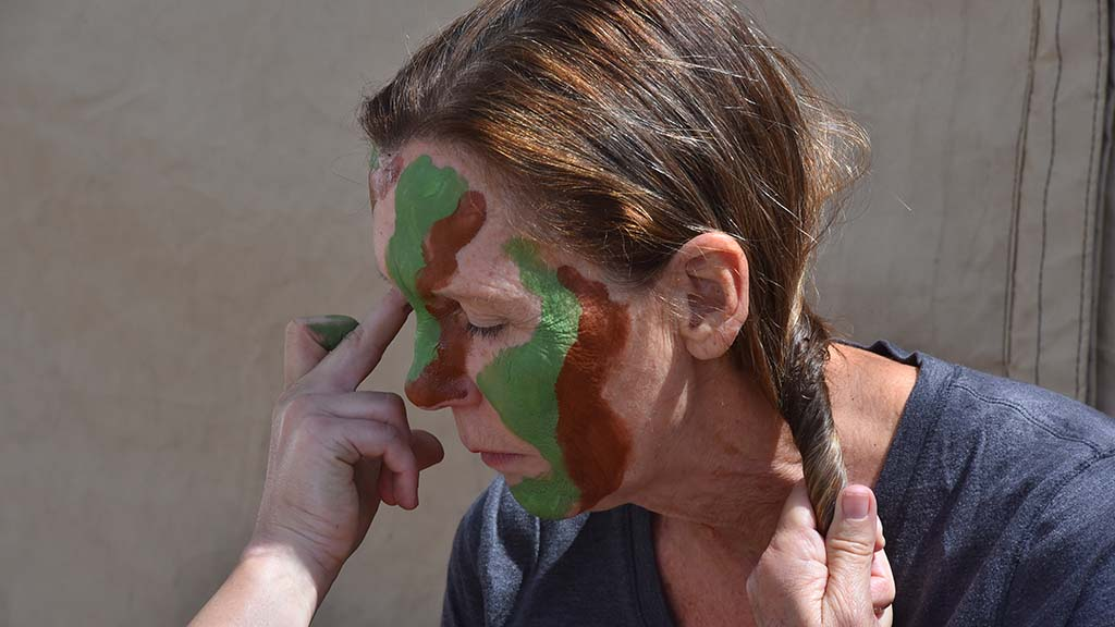 Master Sgt. Marion Albrektsen had her face painted