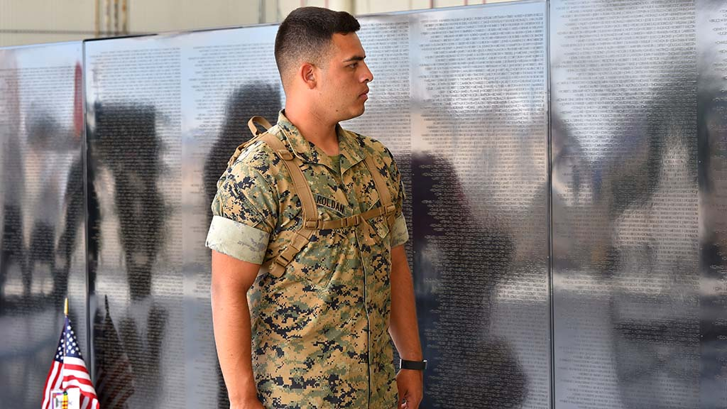 A Marine pauses to visit the mobile Vietnam Memorial Wall