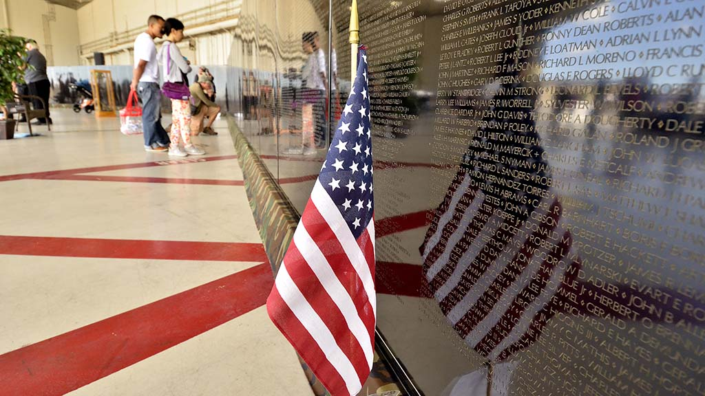 Veterans and air show visitors stopped to view the model Vietnam Memorial Wall
