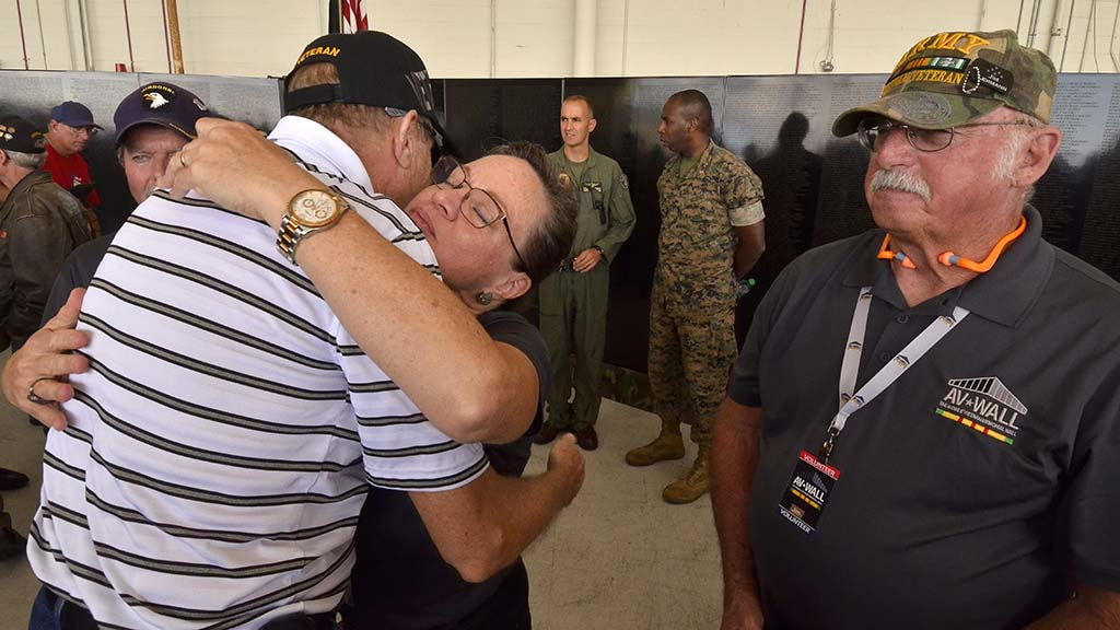 Stacia Nemeth of the mobile wall organization gave a hug to each veteran who received a commemorative pin.