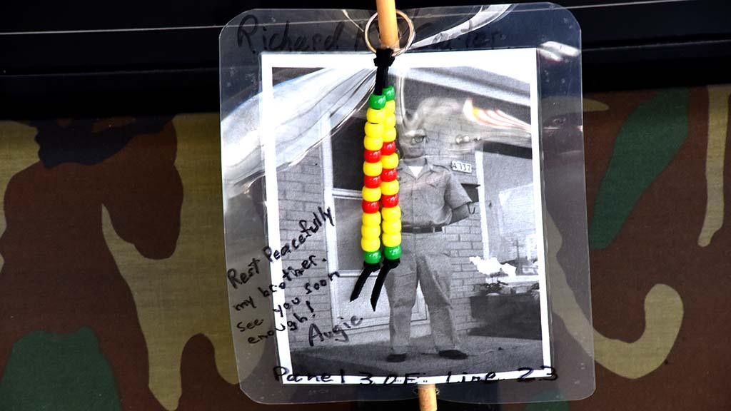 A photo of a Vietnam War veteran was pinned to the Vietnam Memorial Wall.