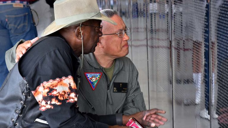 Marine Cmdr. Chaplain Don Bladog comforts Master Chief Charles Dudley who found the name of his petty officer in the war.