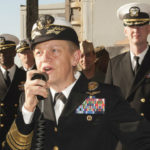 Nora Tyson addresses the crew of amphibious assault ship USS Boxer