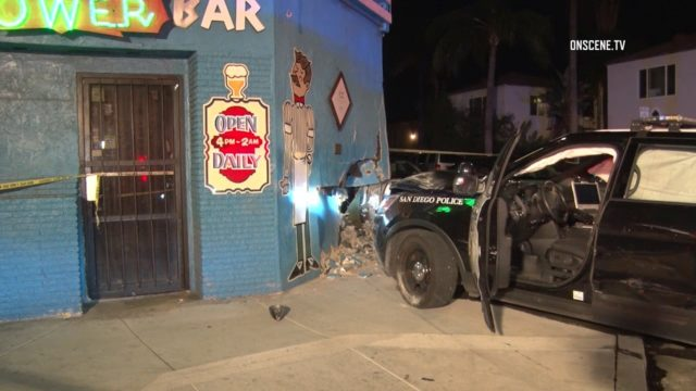 Damaged police cruiser outside the Tower BAr