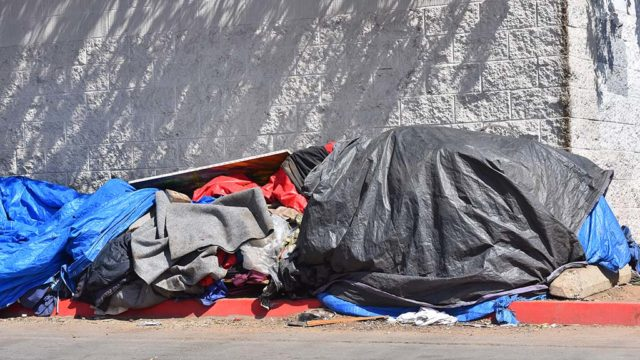 The homeless create temporary shelters in downtown San Diego.