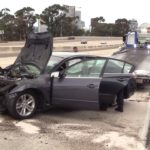crashed Nissan sedan