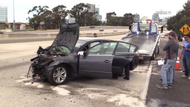 crashed Nissan sedan