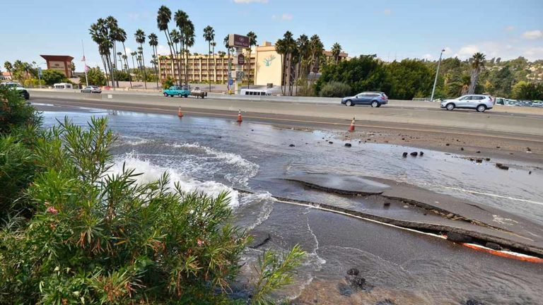 Westbound traffic on Interstate 8 passes scene of burst water pipe.