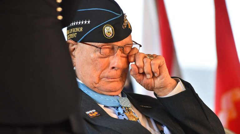 "Medal of Honor recipient Hershel ""Woody"" Williams wipes away a tear"