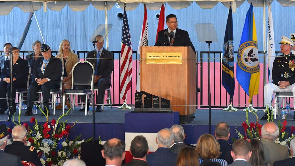 Kevin M. Graney, president of General Dynamics NASSCO, (center) led the christening.