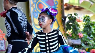 A girl with Ballet Folklorico Real de San Diego performs for the Old Town crowd.