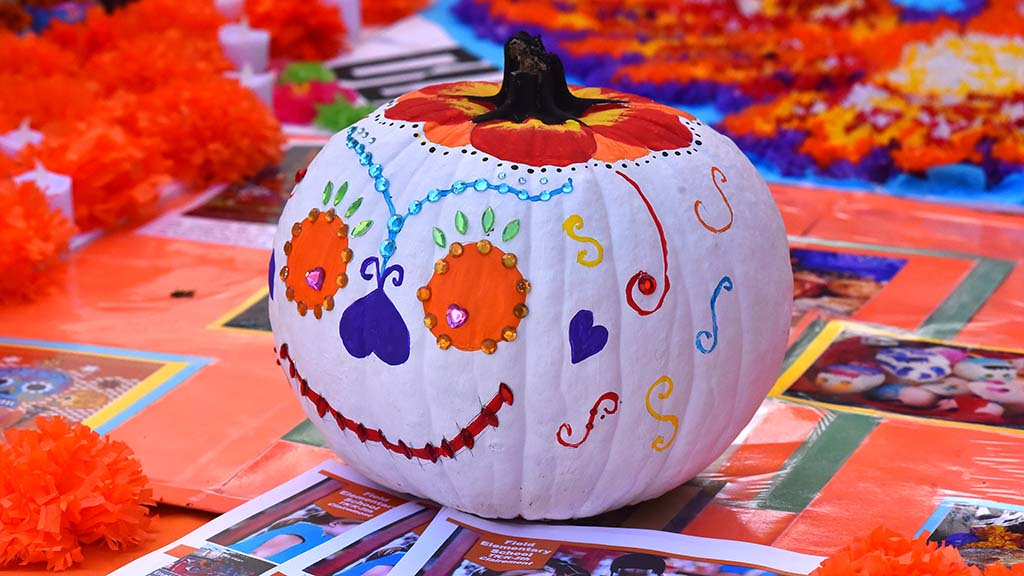 A colorful pumpkin is on display at the Dia de los Muertos event in Old Town.