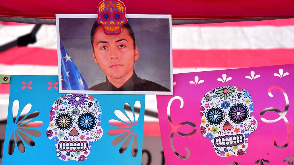 A fallen police officer is honored at an altar at the Dia de los Muertos event in Old Town.
