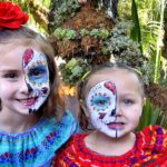 Kate, 7, (left) and Emma, 4, of San Diego have their faces painted