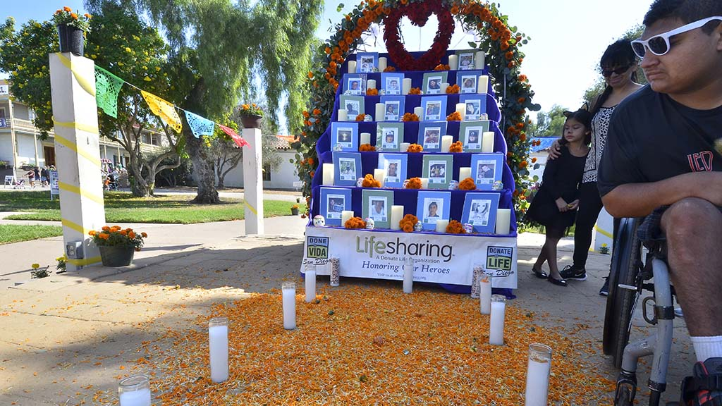 Members of Donate Life San Diego scatter marigold petals to attract the spirits of organ donors.