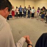 Participants ended their discussion at the Encuentro with a group prayer.