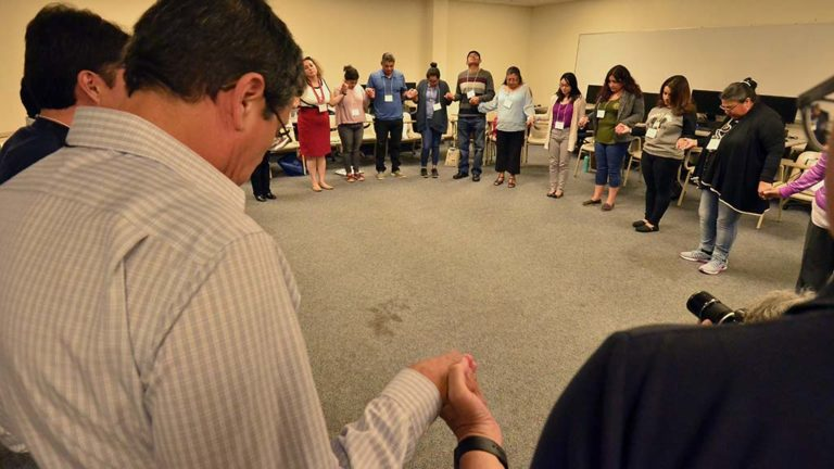 Participants ended their discussion session at the Encuentro with a group prayer.
