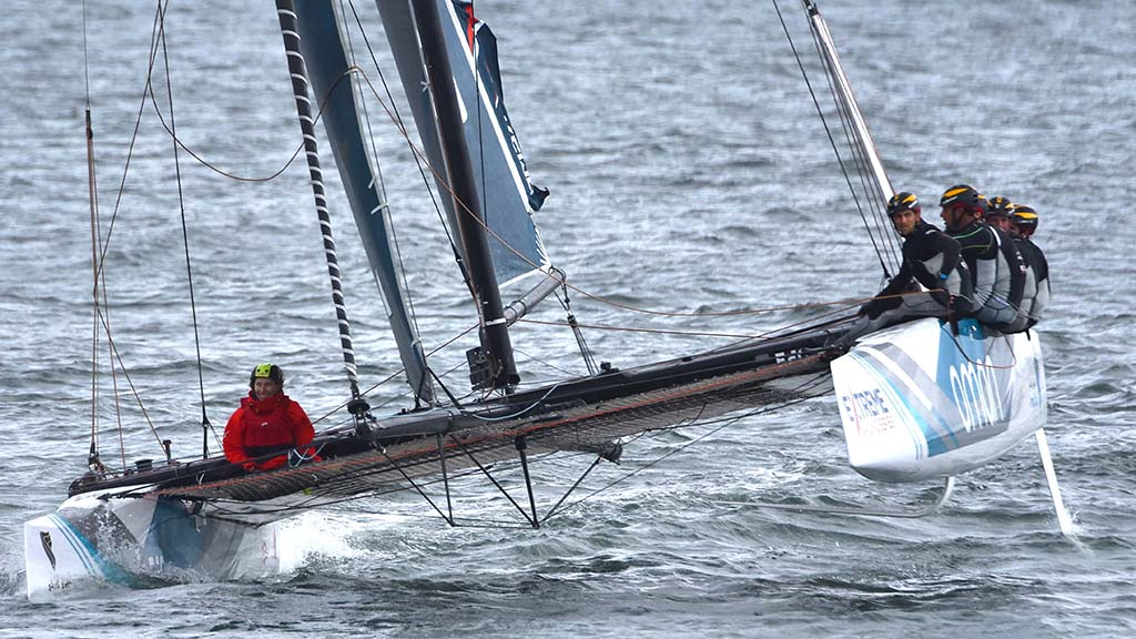 Sailors representing Oman are up on one foil during the race.