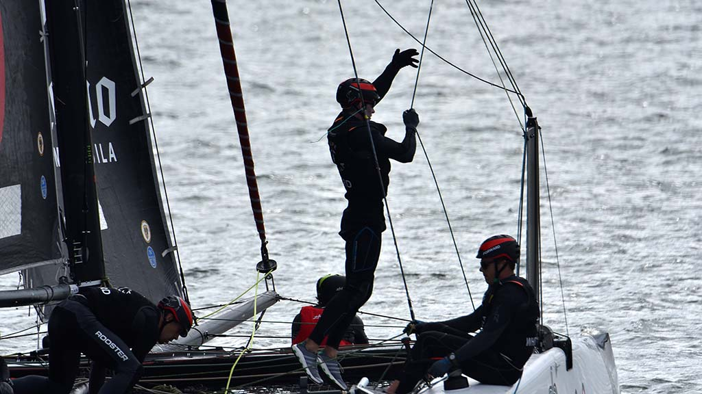 Sailors turn the sails to head back to the finish line.
