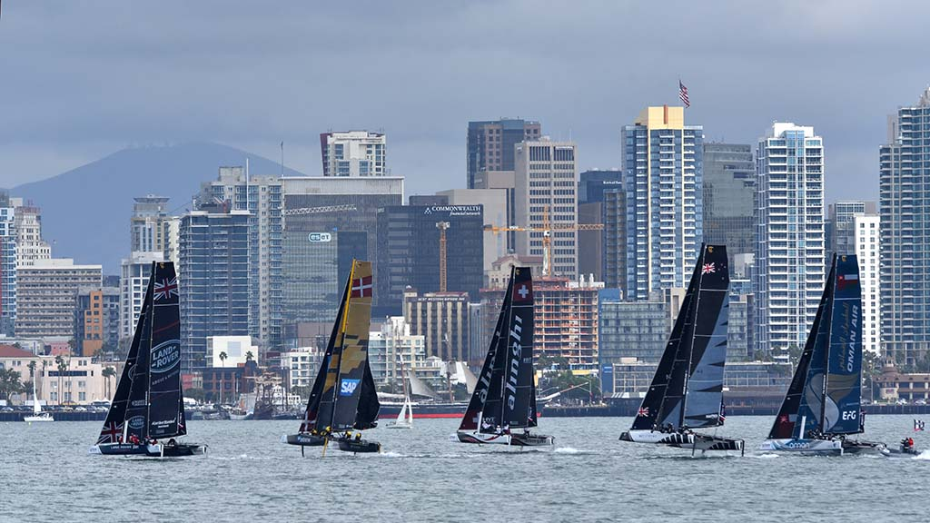 Five of the eight racing boats turn in San Diego Harbor.