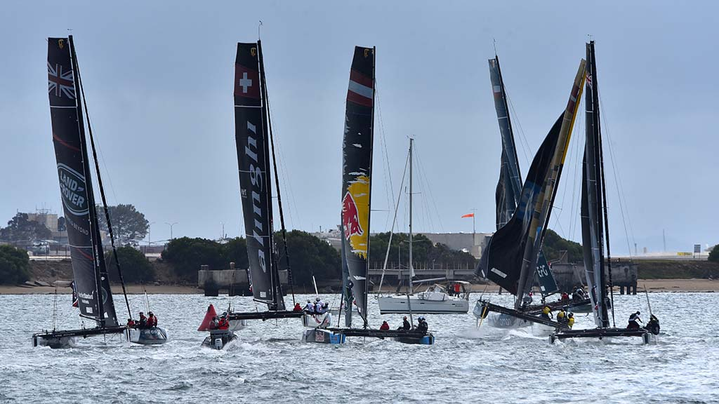 Teams jockey for position before the start of a race in the Extreme Sailing Series.