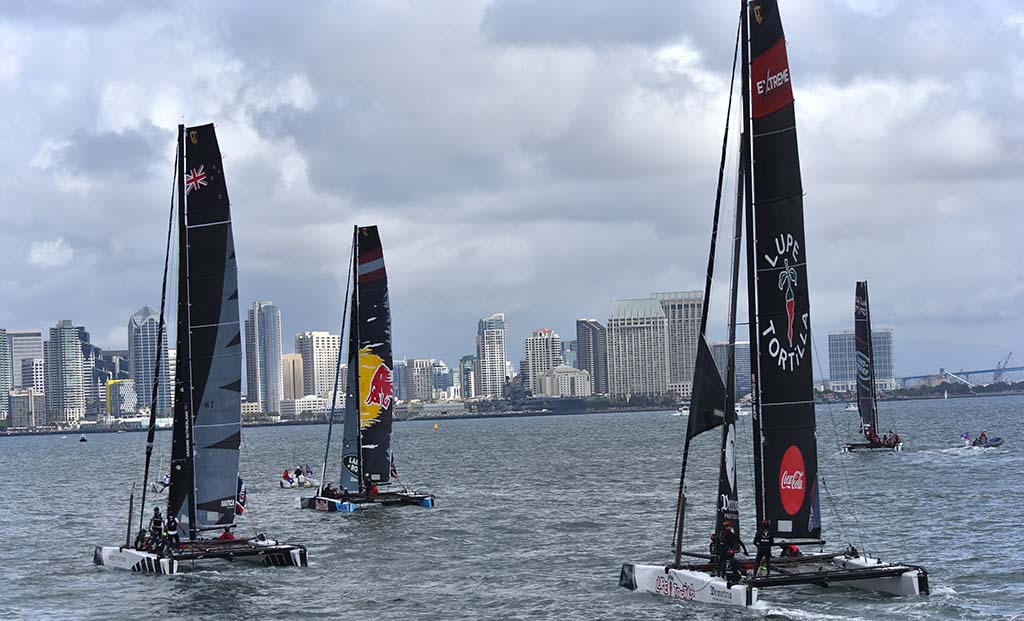 Catamarans race to the half way point in the race toward downtown.