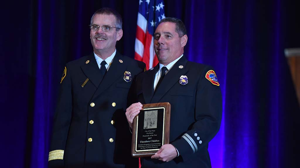San Diego Fire Chief Brian Fennessy poses with Ted Chialtas, who received the Paramedic of the Year award.