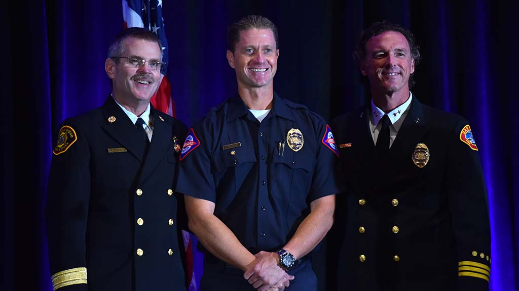 San Diego Fire Chief Brian Fennessy (left) poses with Jacob Magness (center), the 2017 Lifeguard II of the Year,