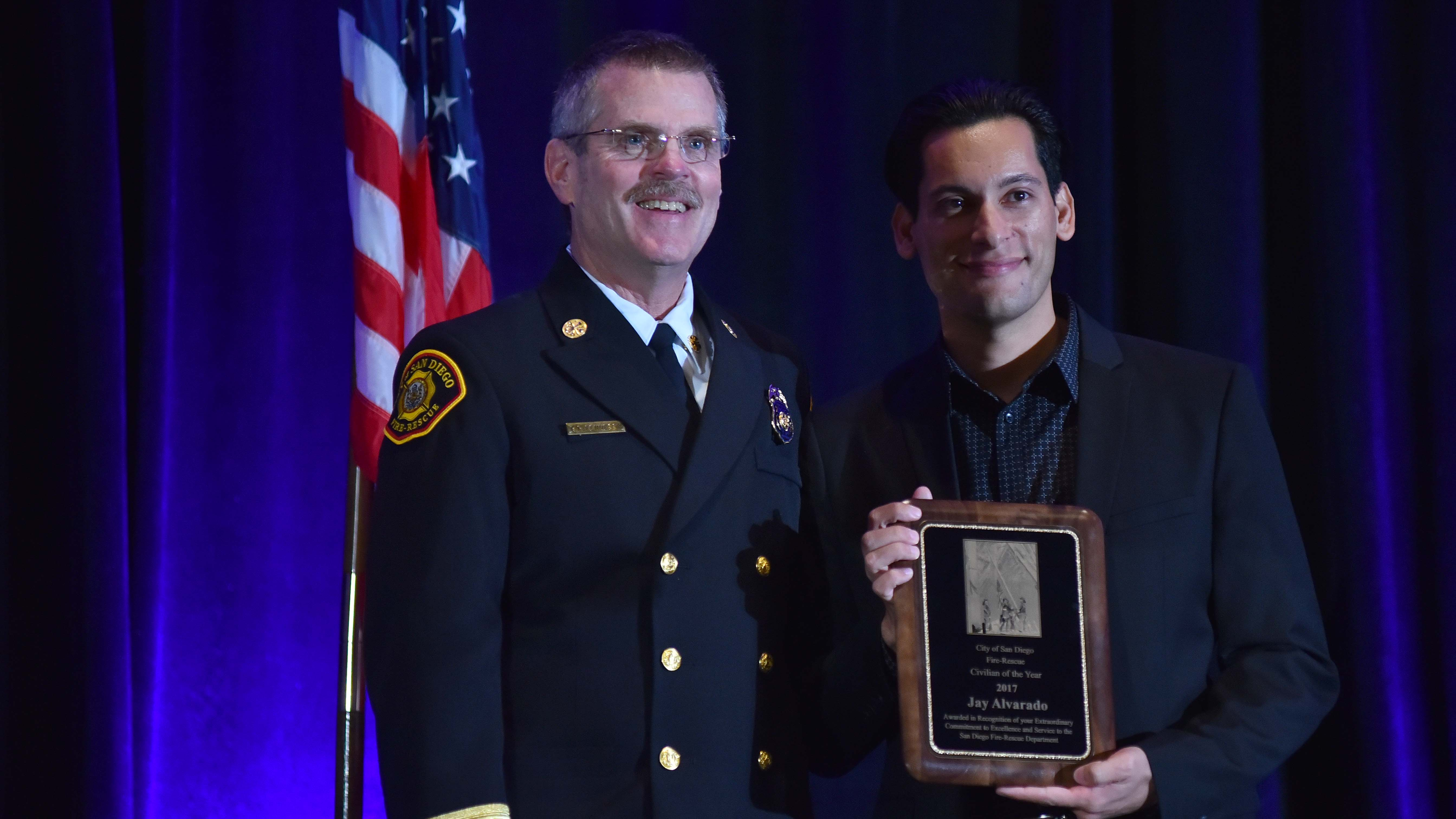 San Diego Fire Chief Brian Fennessy poses with Jay Alvarado, the Civilian of the Year