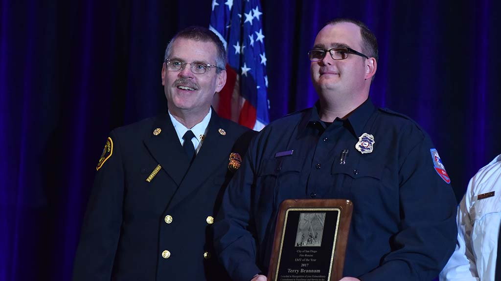 San Diego Fire Chief Brian Fennessy poses with Terry Brannam, who received the EMT of the Year award.