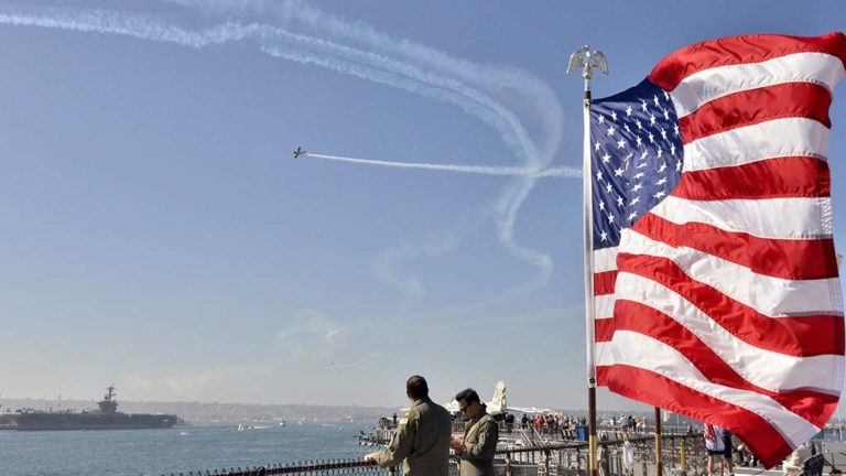 Visitors on the USS Midway watch the aerial performance of the Sea & Air Parade.