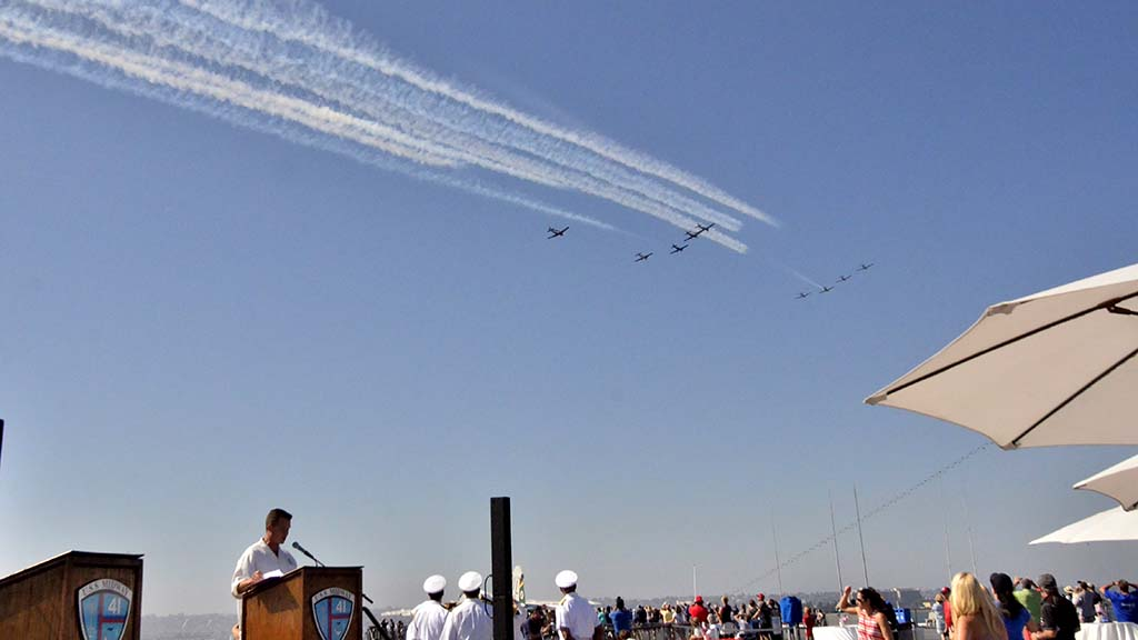 A crowd on the USS Midway watch the aerial performance in the Sea & Air Parade during Fleet Week in San Diego.