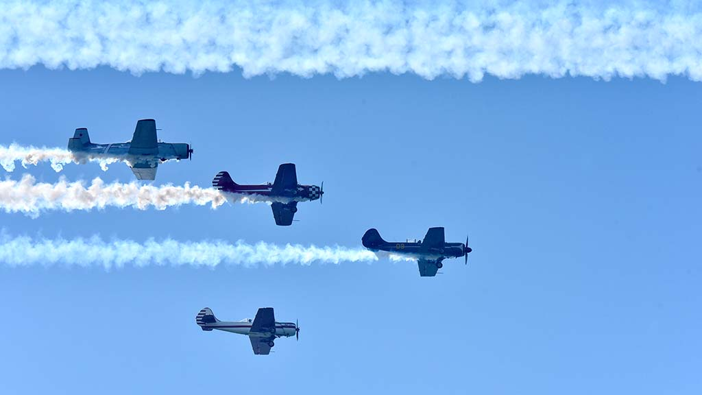 Vintage aircraft do a flyby in the Fleet Week Sea & Air Parade in San Diego.