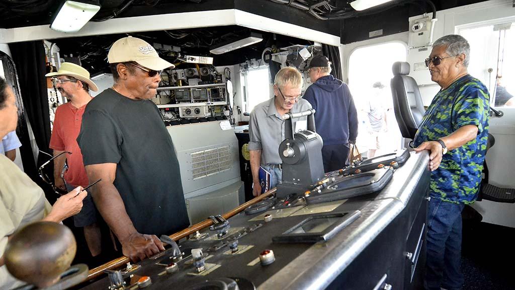 Spectators examine the bridge of the CGC Midgett during ship tours.