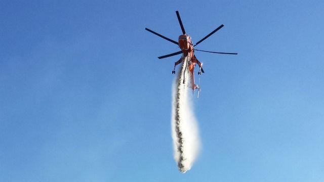 Erickson Aircrane helitanker drops water