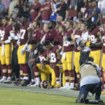 Washington Redskins team members kneel