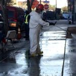 City workers use a combination of water and bleach to clean downtown sidewalks.
