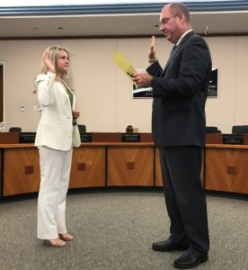 School Superintendent Brian Marshall swears in Rebekah Basson as member of La Mesa-Spring Valley school board in August.