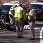California Highway Patrol officers inspect scene of fatal crash of motorcyclist on state Route 94 in Dulzura.