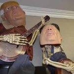 Banjo-playing skeletons are decorated this year by masks of President Trump and Kim Jong-un.