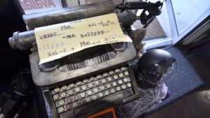 A self-typing typewriter sends out a plaintive message.