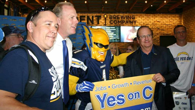 "Dan ""Boltman"" Jauregui win Chargers owner Dean Spanos and San Diego Mayor Kevin Faulconer."