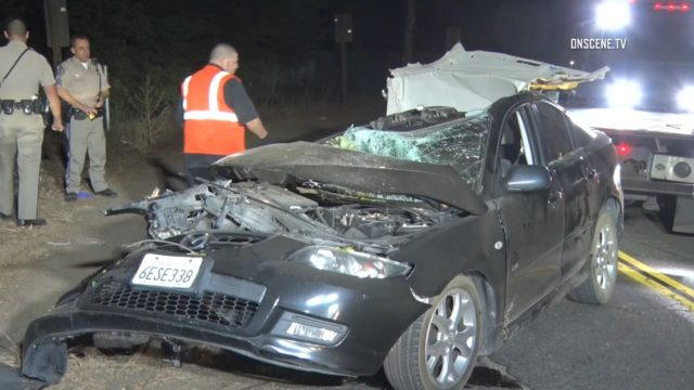 CHP officers with wrecked car